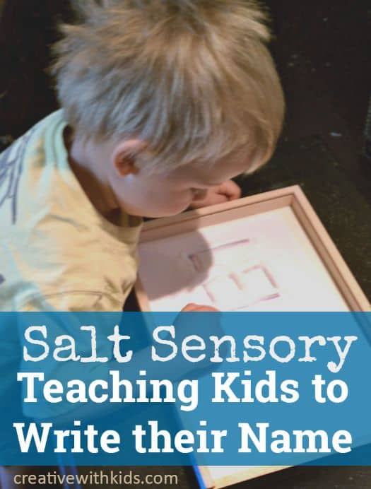 Writing in a sensory tray with salt