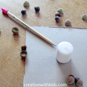 acorn craft - tracing the candle onto cardboard