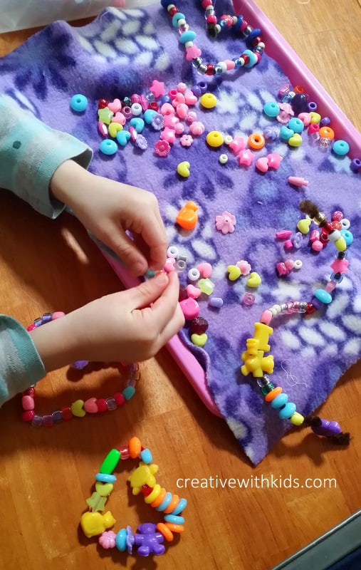 Pipecleaners and beads - fuzzy cloth to keep beads still