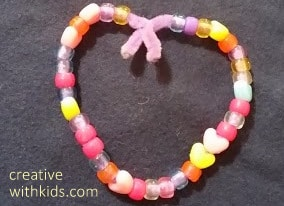 bend bead covered pipe cleaner into a heart