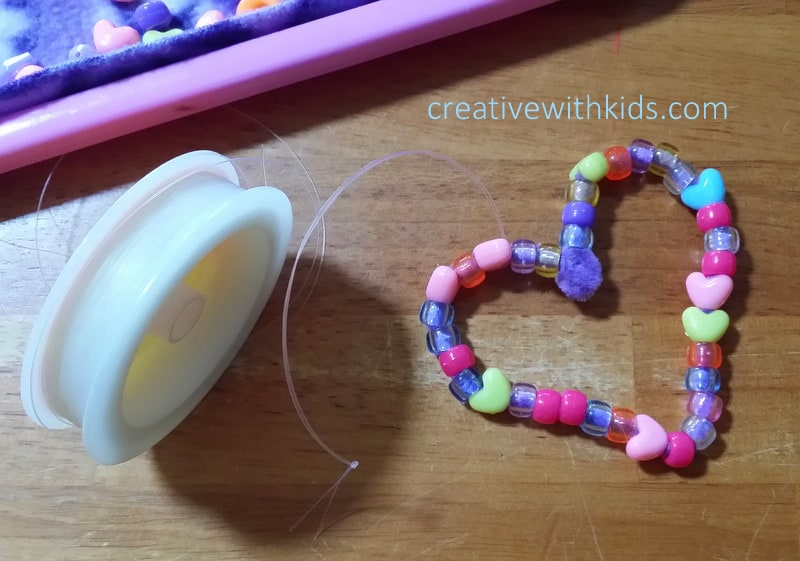 use fishing line to hang bead hearts