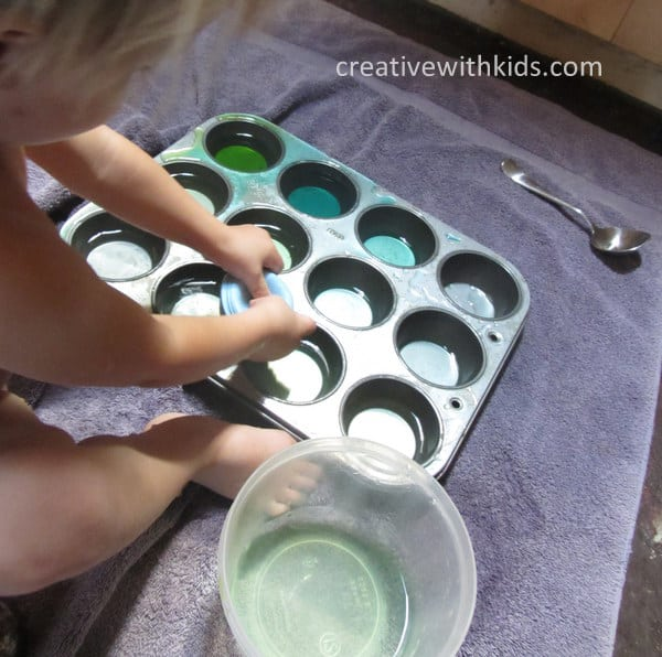 Water Play with containers on towel